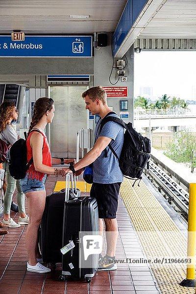 Florida  Miami  Metromover  station  public transportation  platform  passenger  waiting  luggage  man  woman  couple