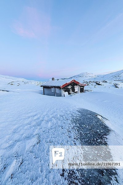 Isolated house in fields of ice and snow  Riksgransen  Abisko  Kiruna Municipality  Norrbotten County  Lapland  Sweden.
