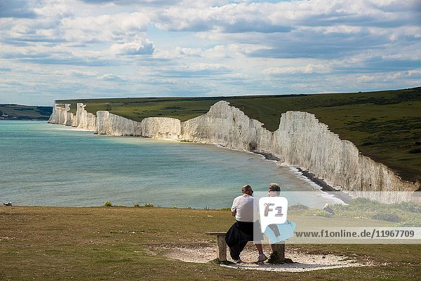 Couple watching Seven Sisters  cliff coast at Beachy Head  Sussex  England