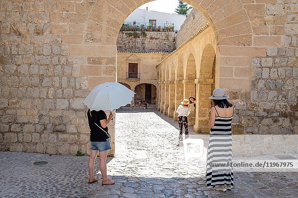 Chinese tourist taking pictures in the inner ward  portal de Las Taules  ibiza  Ibiza  Balearic Islands  Spain.