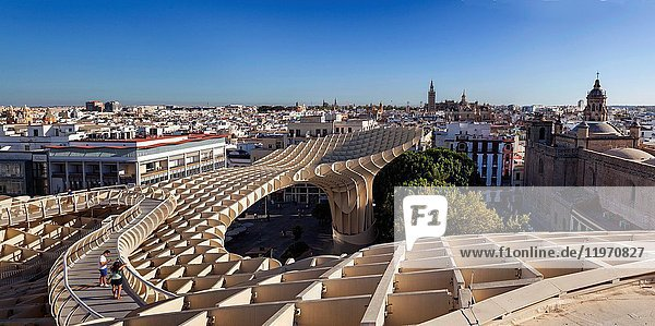 Metropol Parasol  Mushrooms of the Incarnation is a wooden structure with 2 columns of concrete that house elevators to the lookout and is located in the central Plaza de la Encarnacion in Seville  Andalucia  Spain.