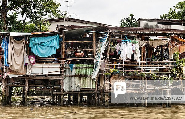 Typical wooden waterside houses on the Khlongs in Thonburi  Bangkok  Thailand.
