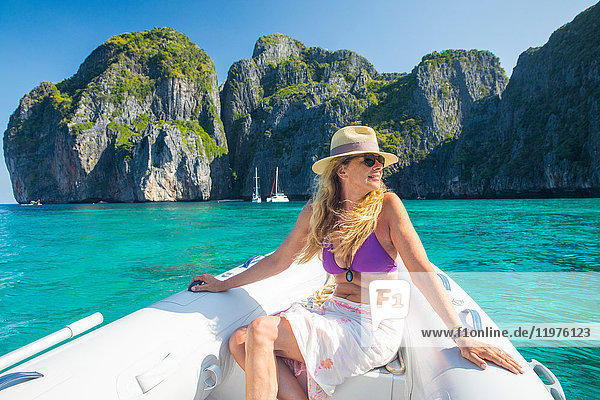 Woman relaxing on yacht  Koh Phi Phi Leh  Thailand  Asia