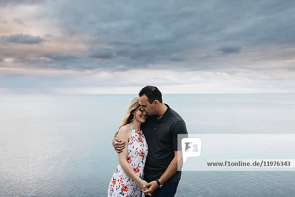 Romantic couple hugging by water  Oshawa  Canada