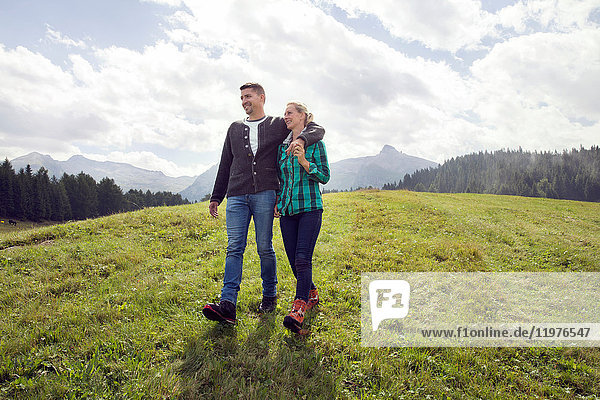 Couple walking in field  Tirol  Steiermark  Austria  Europe