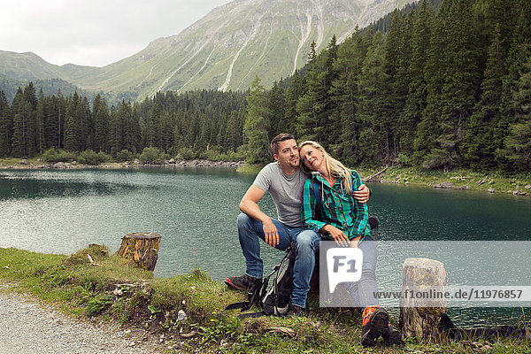 Couple hiking  sitting by lake  Tirol  Steiermark  Austria  Europe