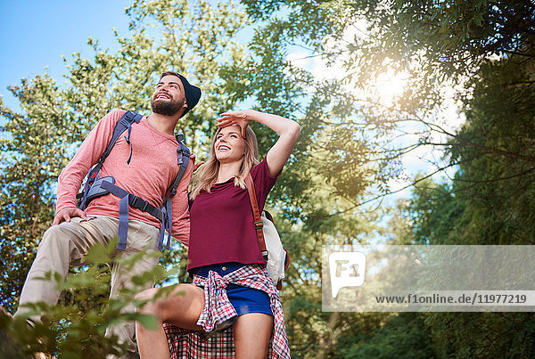 Low angle view of couple hiking  looking away  Krakow  Malopolskie  Poland  Europe