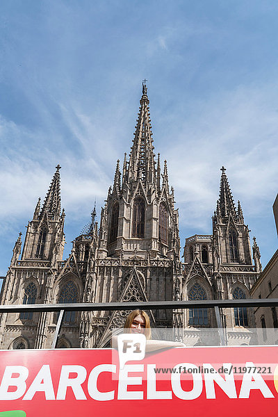 Woman on open top bus in front of Barcelona Cathedral  Barcelona  Catalonia  Spain  Europe