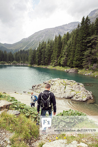 Couple hiking by lake  Tirol  Steiermark  Austria  Europe