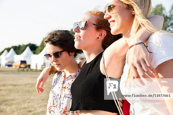 Three female friends enjoying festival