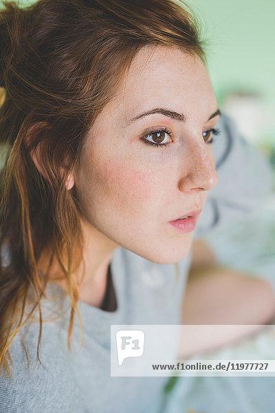 Close up portrait of beautiful young woman gazing