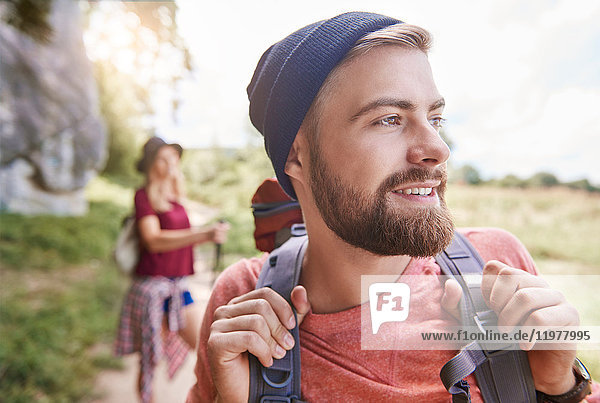 Portrait of man hiking looking away smiling  Krakow  Malopolskie  Poland  Europe