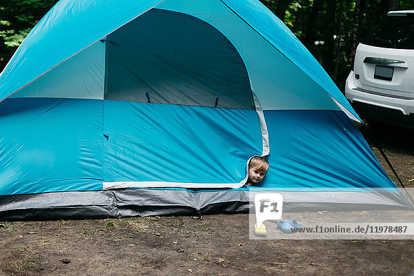 Head shot portrait of cute male toddler peeking from blue tent  Huntsville  Canada
