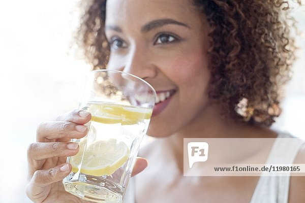 Mid adult woman drinking water.