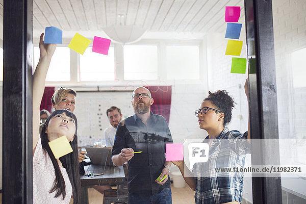 Group of coworkers brainstorming in office