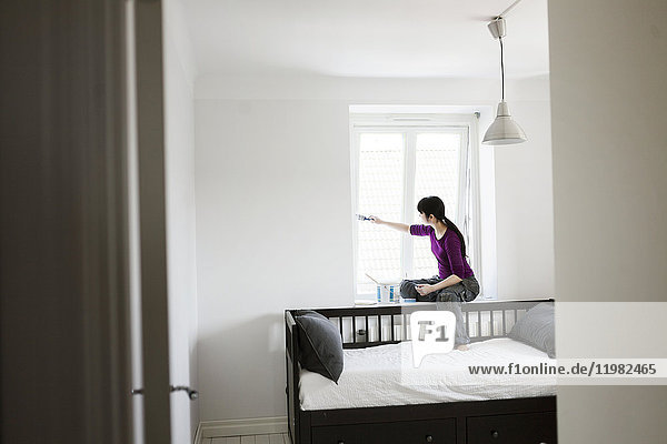 Woman painting window