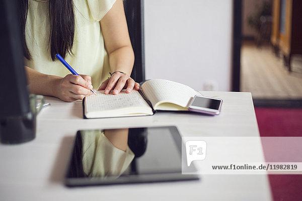 Woman working by desk