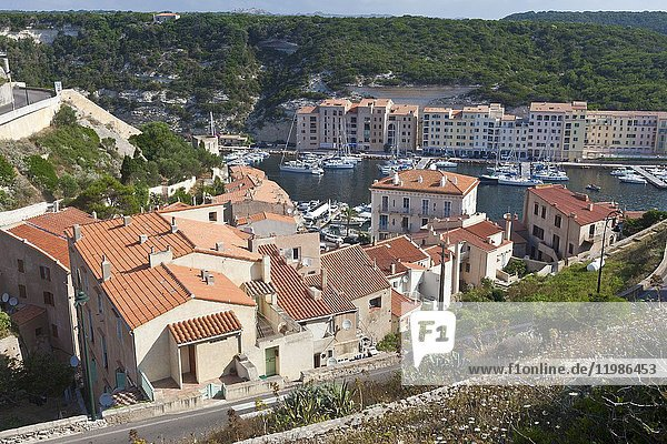 Typical architecture of houses and buildings of the old town framed by the harbor Bonifacio Corsica France Europe.