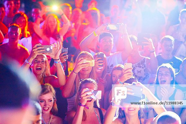 Excited people with smartphones during Summer Party at music festival Starbeach in Hersonissos  Crete  Greece  on 09. July 2017