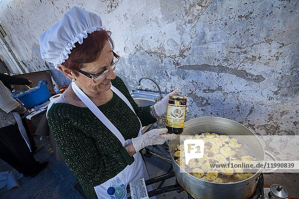 Cooking Cod Fritters in the 1st Day of Honey Cane Frigiliana. Frigiliana  Andalusia  Spain  Europe.