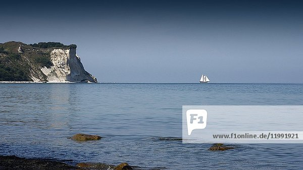 Sailing ship at the horizon of Baltic Sea and the limestone cliffs on the Left  Cape Arkona  Island of Rügen  Mecklenburg-Western Pomerania  Germany.