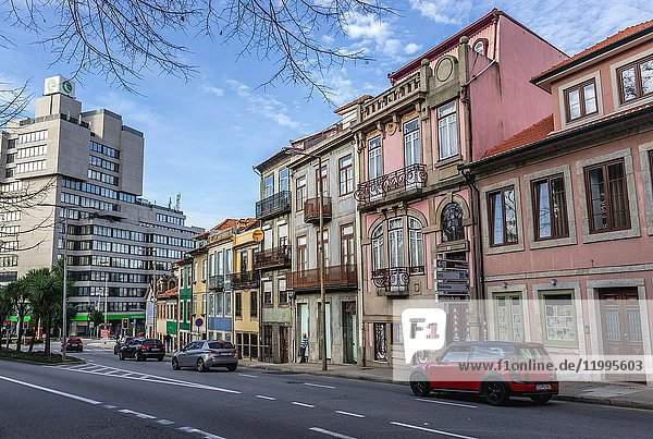 Town houses on Rua de Dom Manuel II street in Porto  second largest city in Portugal. Edificio Tranquilidade office building on left.