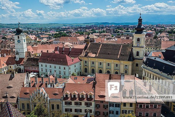 Aerial view with Holy Trinity Church and Council Tower from Lutheran Cathedral of Saint Mary in Historic Center of Sibiu  Transylvania  Romania.