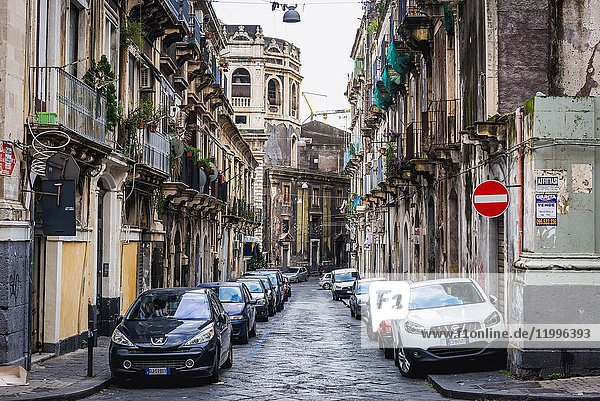 Narrow street on the old part of Catania city on the east side of Sicily Island  Italy.