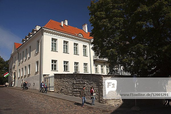 People in front of the Hungarian Embassy building on Toompea Hill in the old town  Tallinn  Estonia  Baltic States  Europe.