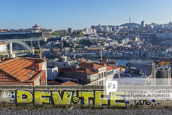 Aerial view on the Old part of Porto city on Iberian Peninsula  second largest city in Portugal. Vila Nova de Gaia city on background.