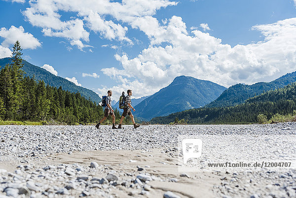 Germany  Bavaria  two hikers walking in dry creek bed