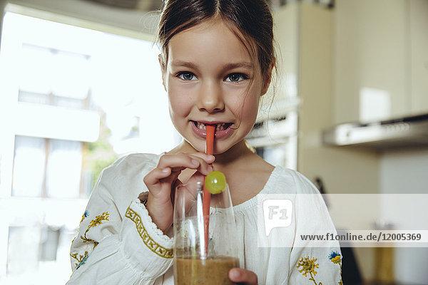 Girl enjoying her homemade smoothie