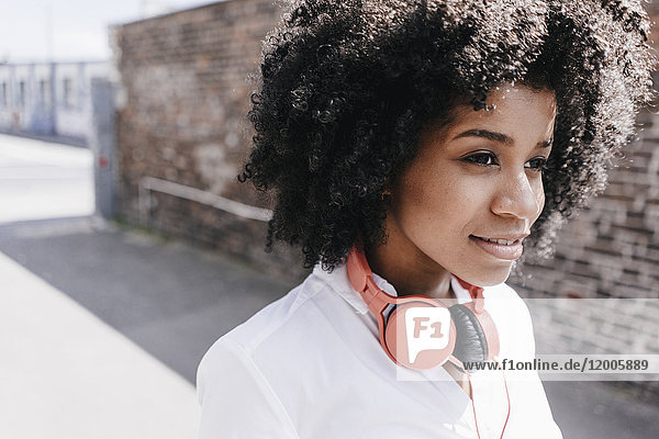 Young woman wearing headphones outdoors
