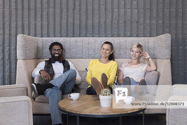 Portrait of smiling friends in lounge