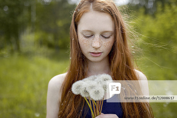Caucasian girl with dandelion seeds hair