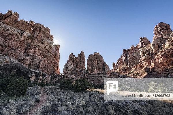 Sun in blue sky over desert  Moab  Utah  United States