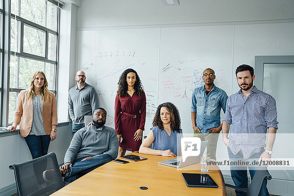 Portrait of diverse business people in conference room