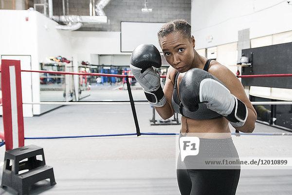 Black woman posing in boxing ring