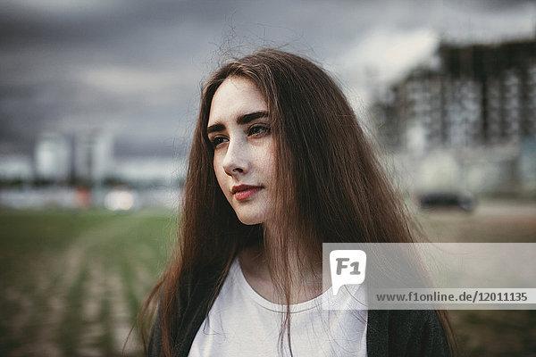 Pensive Caucasian woman outdoors