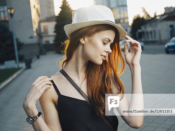 Smiling Caucasian woman in city