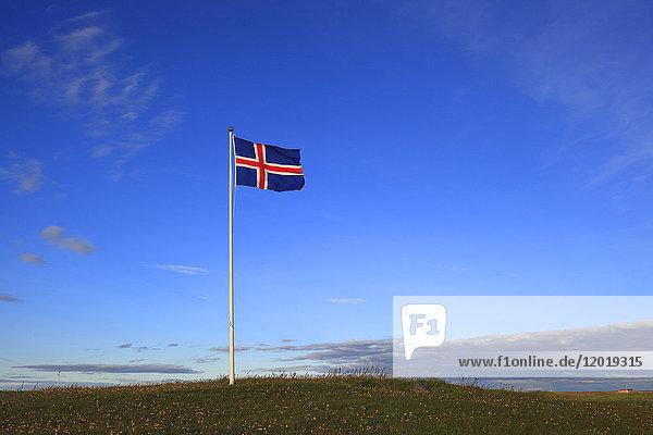 Iceland  flag in blue sky.