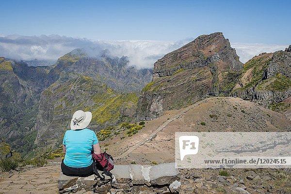 Hiker resting  vereda Areeiro   Madeira  Portugal.