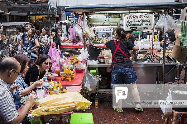 Noodle stand  Street food market  at Itsara nuphap  Chinatown  Bangkok  Thailand.