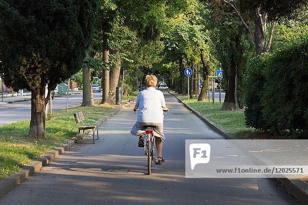 Woman cycling in marghera  Italy