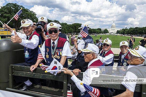Washington DC  District of Columbia  National Memorial Day Parade  staging area  float  Jeep  Korean War Veterans  Capitol Building  Asian  man  senior