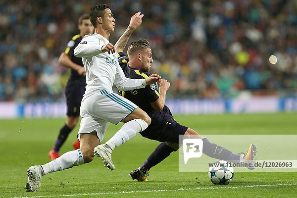 MADRID  SPAIN - Cristiano Ronaldo and Alderweireld struggle for the ball. Real Madrid and Tottenham Hotspurs tied 1-1 in a fixture corresponding to Matchday 3 of the Champions League group stage. Santiago Bernabeu Stadium. October 17  2017. Photo by Antonio Pozo / PHOTO MEDIA EXPRESS.