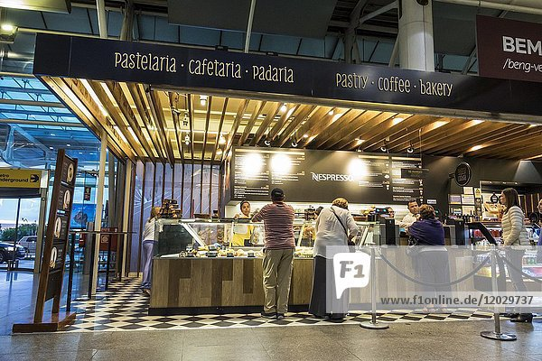Portugal  Lisbon  Humberto Delgado Airport  LIS Portela Airport  terminal  Padaria Lisboa  bakery  coffee shop  counter  man  woman  customers