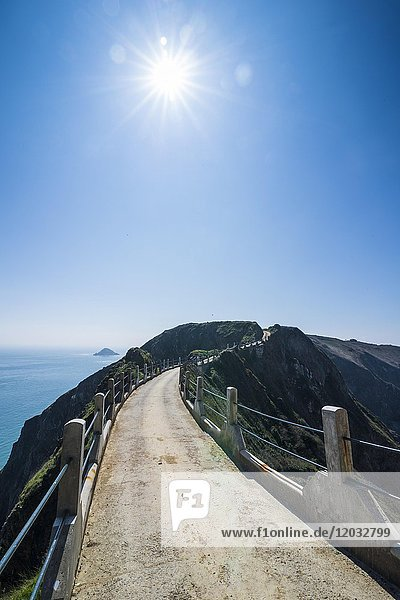 Road connecting the narrow isthmus of Greater and Little Sark  Channel islands  Great Britain