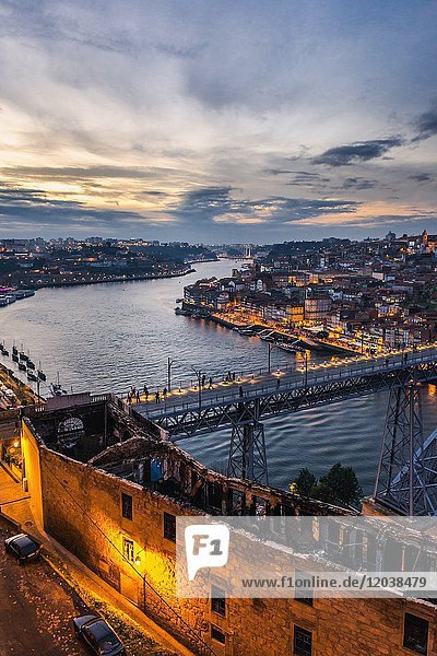 Sunset over Porto city  second largest city in Portugal. Aerial view with Dom Luis I Bridge from Serra do Pilar viewpoint in Vila Nova de Gaia city.