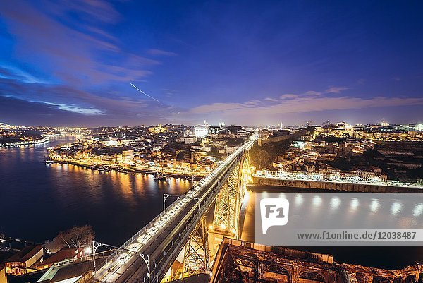 Evening in Porto city  Portugal. Aerial view from Serra do Pilar viewpoint in Vila Nova de Gaia city with Dom Luis I Bridge over Douro River.
